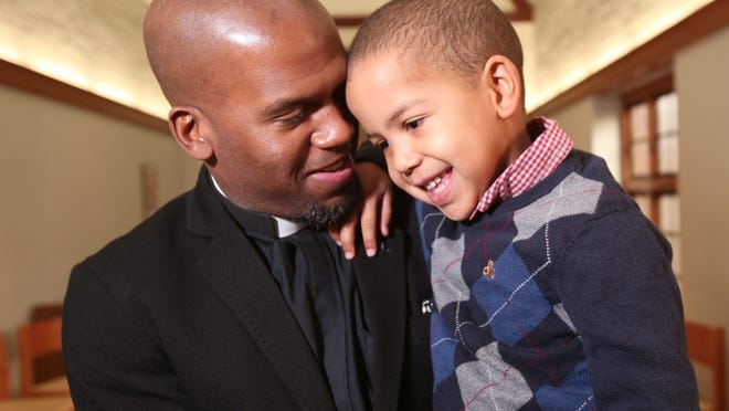 The Rev. Owen Thompson, rector of Grace Episcopal Church in Nyack, talks to his son, Carter, 4, at the church in Nyack Dec.4, 2014.