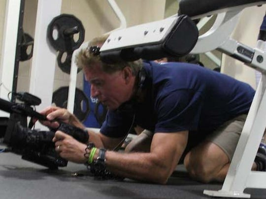 "Michigan Emmy-winning director/producer Keith Famie works to film a scene in his new documentary, ""Death is NOT the Answer,"" at the Hamburg Fitness Center earlier this month."