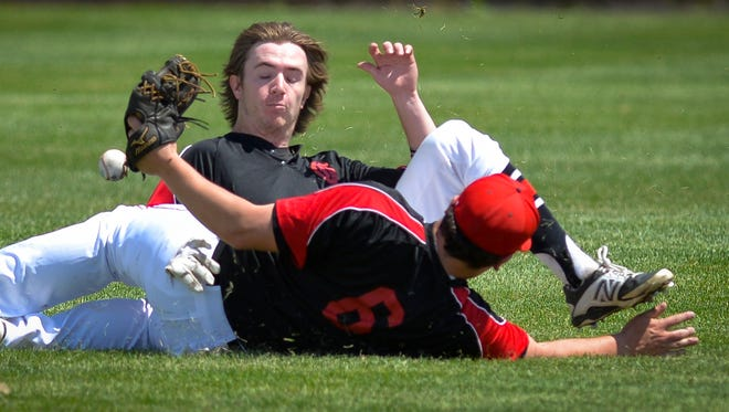 The ball bounces between St. Augusta Gussies center fielder Marcus Lommel (8, center) and second baseman Mitch Gwost (6) in the second inning against the Kimball Express Sunday, May 29, in Kimball.