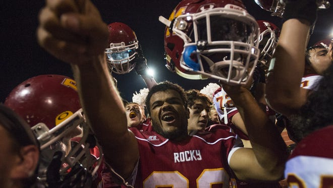 Autry Baskin and the Rocky Mountain High School football team celebrates a 35-24 win over Poudre at French Field Friday, October 16, 2015. The Lobos face Mullen in the Class 5A playoffs on Friday.