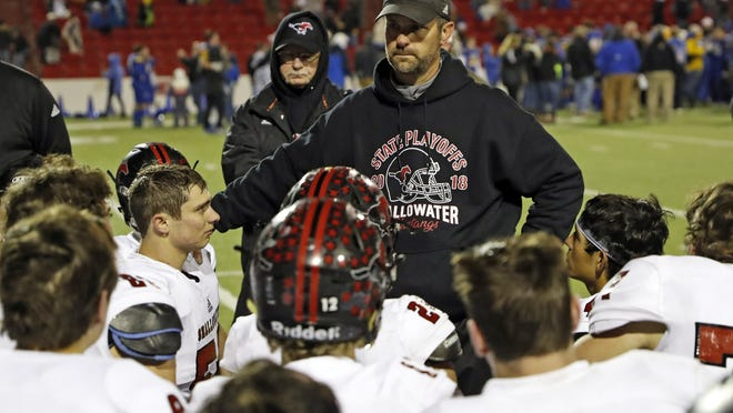 Shallowater coach Bryan Wood talks to his players after a 2018 state quarterfinal against Brock. The Mustangs, 7-5 last season, will face several unfamiliar opponents this year after the UIL realignment moved them into District 1-3A Division I.