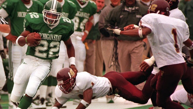 Former Spartan tailback Shawn Foster eludes CMU defender Wayne Dudley during the Spartans' 1998 win over the Chippewas at Spartan Stadium