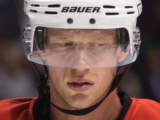 Carolina Hurricanes' Eric Staal prepares to take a face-off against the Vancouver Canucks during the first period of an NHL hockey game, Tuesday, Oct. 28, 2014 in Vancouver, British Columbia. (AP Photo/The Canadian Press, Darryl Dyck)