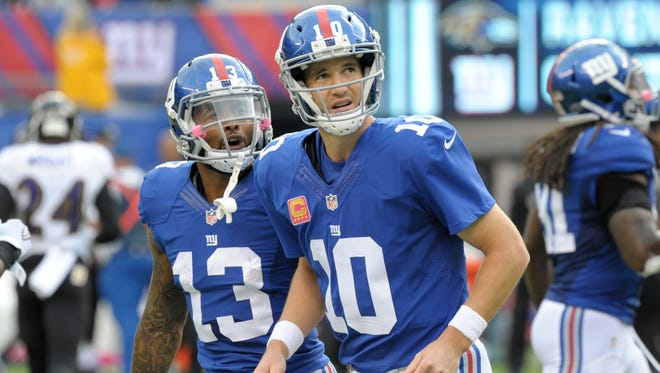New York Giants wide receiver Odell Beckham (13) and Eli Manning (10) celebrate during the second half of their win over the Baltimore Ravens Sunday.