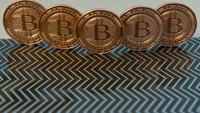 File photo taken in 2014 shows medals of digital currency called bitcoins.