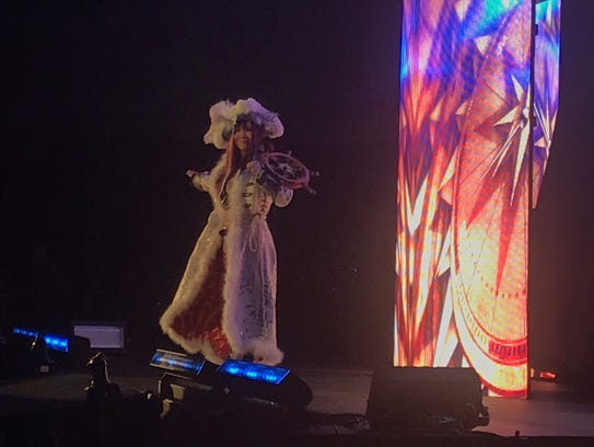 Kairi Sane makes her entrance at an NXT event in Toms