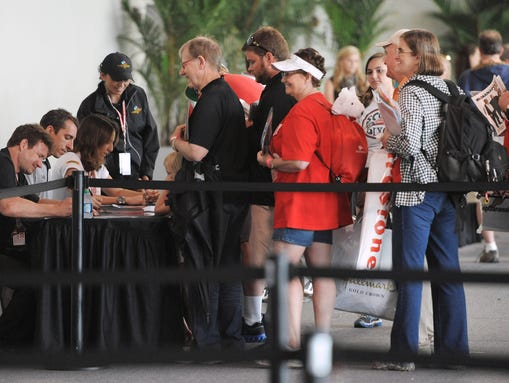 Fans line up to get autographs from drivers (from left) Buddy Lazier, Justin Wilson and Ana Beatriz during Community Day at the Indianapolis Motor Speedway on Wednesday, May 22, 2013. Matt Detrich / The Star