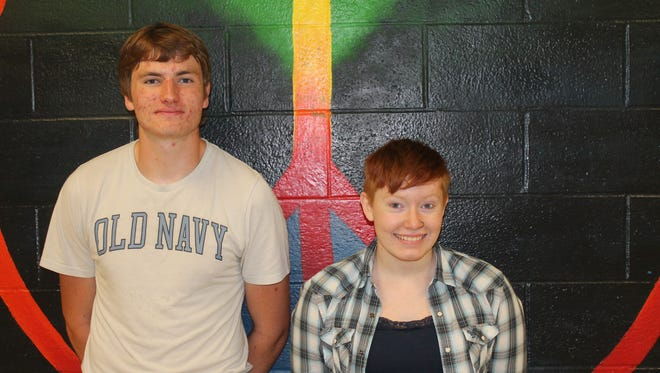 Corey Mead, left, and Savannah Sitzer designed the new flyer for the SVE Food Cupboard.