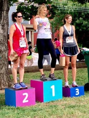 Julie Mix McPeak, right, commissioner of the Tennessee Department of Commerce and Insurance, carves out time to run. She came in third in her category in the Tomato 5k in East Nashville on Aug. 12, 2017. McPeak said 5k runs are fun because she set a good pace. When running five-miles, she said she aims for a 9-minute mile pace.