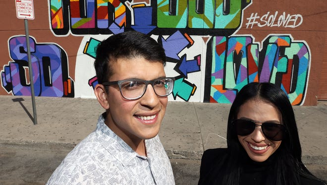 Daniel Ortega, left, and Biyanca Gomez of The Gap Collective show a newly painted mural on a wall along Fourth Street near the intersection with South El Paso Street.