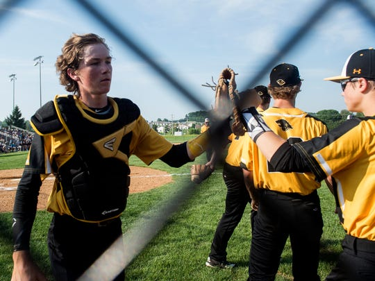 Red Lion catcher Channing Bratten, right, high fives