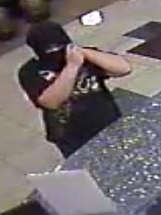 One of the suspected robbers in the Aug. 9 armed robbery at the Best Western in Fairview Township.
