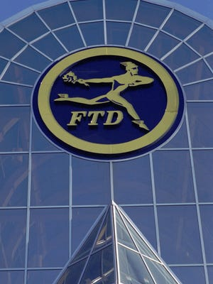 "FTD and Classmates.com have reached an $11 million multi-state settlement over deceptive advertising and billing practices. FTD was incorporated in Michigan, but today is based in Illinois. This 1994 photo is of its Southfield headquarters at the time.   ADVANCE FOR SUNDAY NOV. 6--The Florists' Transworld Delivery Association logo is shown on the glass-covered artium entranceway of the headquarters building in Southfield, Mich., Nov. 2, l994. For more than half a century, FTD florist had a lock on the market for ""wired"" flowers, but now the 84-year-old cooperative is considering a takeover bid.   (AP Photo/Richard Sheinwald   NY331"