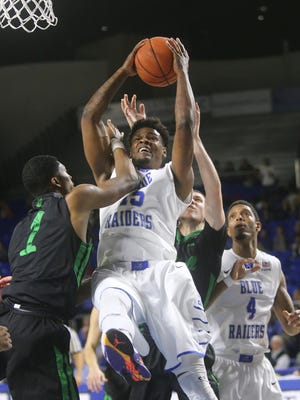 MTSU's Aldonis Foote (15) grabs a rebound over Marshall's Terrence Thompson (1). Foote has averaged nearly seven points a game in extended minutes late this season.