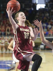 Riverdale's Amanda Whittington (12) goes up for a shot against Morristown during the State Tournament quarterfinals , on Wednesday March 9, 2016, at MTSU.