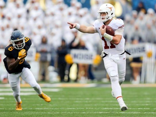 Texas Longhorns quarterback Sam Ehlinger runs the ball