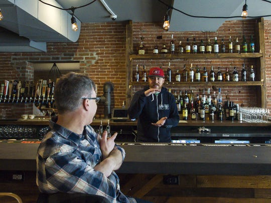 The Archives arcade bar co-owner Matt Walters, left,