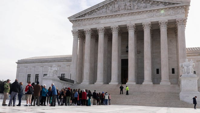Visitors waited outside the Supreme Court as justices heard arguments in a Maryland gerrymandering case.