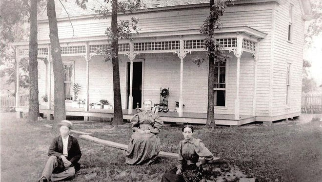 Portland's Moye-Green House in 1896. Pictured are unidentified guest, Kate Barker Moye and Mallie Barker.