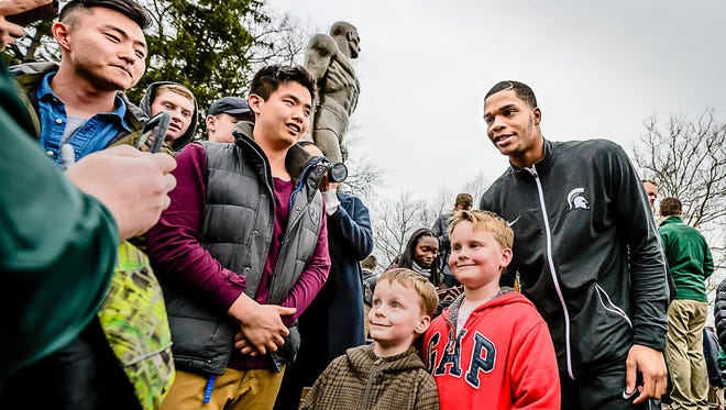 MSU freshman men's basketball player Miles Bridges ,right, poses for a photo with Thomas and Jack Lock at a press conference at the Sparty statue.