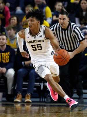 Michigan guard Eli Brooks brings the ball up court during the second half Sunday against Binghamton.