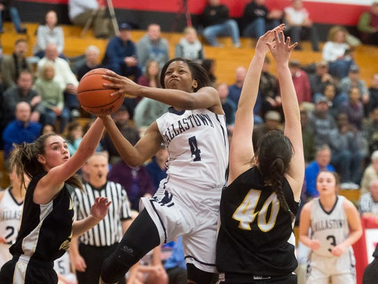 Dallastown's Sabria Royal (4) puts the ball up against