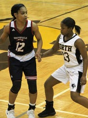 Southfield's Cheyene McEvans (12) attempts to get past North Farmington defender Khyra King-Ealy in this early-season OAA Red Division encounter.