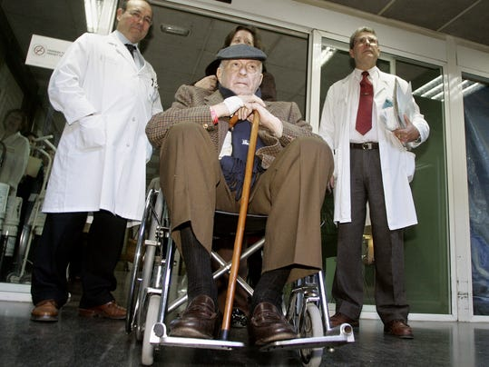 FILE -  In this Jan. 19, 2006 file photo, former Real Madrid soccer star and the club's honorary president Alfredo di Stefano from Argentina leaves La Fe hospital in Valencia, Spain. Real Madrid on Monday July 7, 2014 says Alfredo Di Stefano has died at age 88. Di Stefano helped Madrid win five straight European Champions Cups, and was voted European player of the year in 1957 and '59. He was 88 years old. (AP Photo/Fernando Bustamante, File)