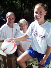 Christie Pearce with her parents in 1999.
