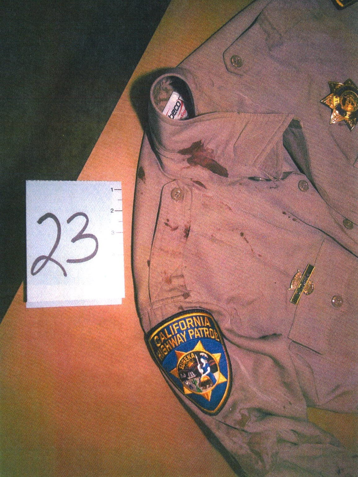 Officer Dane Norem's bloody uniform is photographed
