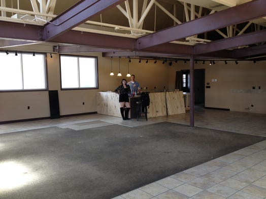 Shawn Elmore and Kira Lowery work on the interior space of Elmore's future jazz lounge, to be called KimBrew, on Monday.