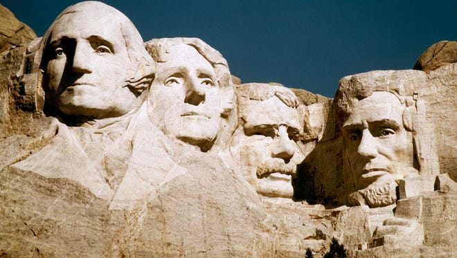 The statues of George Washington, Thomas Jefferson, Teddy Roosevelt and Abraham Lincoln are shown at Mount Rushmore in South Dakota.