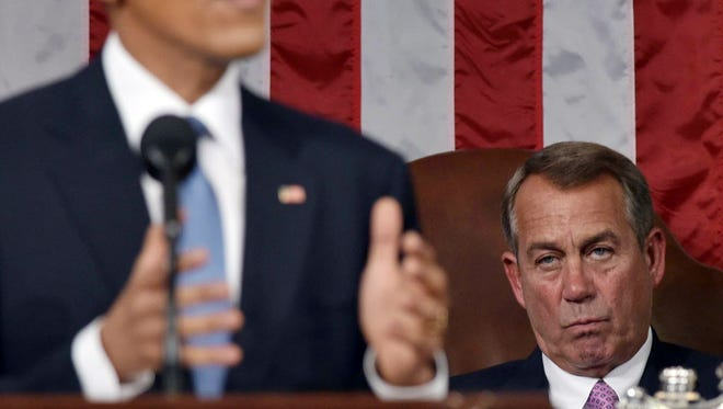 House Speaker John Boehner watces President Obama delivers the State of the Union Address on Jan. 20, 2015.