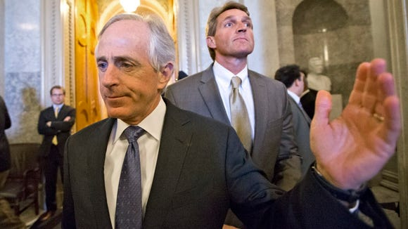 Sen. Bob Corker, R-Tenn., left, and Sen. Jeff Flake, R-Ariz., in 2013.
