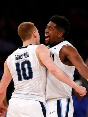 Villanova Wildcats forward Kris Jenkins (2) celebrates with guard Donte DiVincenzo.