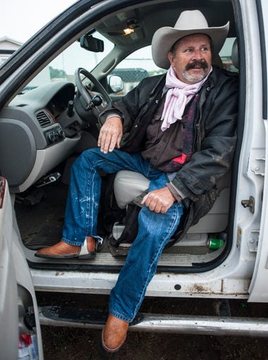 Rorrie Toren sits in his truck and considers rallying the competitors to ride anyway after the State O-Mok-See Championship at Great Falls Saddle Club was cancelled the morning of due to the soggy arena Saturday, September 5, 2015. He was paralyzed from the waist down in 1976 during a rodeo, but continues to ride competitively with the help of a modified saddle and stirrups.