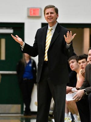 St. Xavier head coach Kevin Klein reacts to a call during action of their game against Male, Friday, Feb. 03, 2017 in Louisville Ky.
