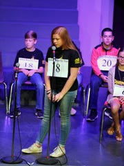 In this file photo, Harlee Hellums spells a word during the 19th annual Big Country Spelling Bee in March 2017 at Hardin-Simmons University's Van Ellis Theater. The local bee returns Saturday after a one-year absence.