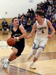 Bo Buttermore drives to the basket on Logan's Colton Landis during Tri-Valley's 74-38 loss in a Division I central district tournament game on Saturday at Jim Myers Gymnasium.
