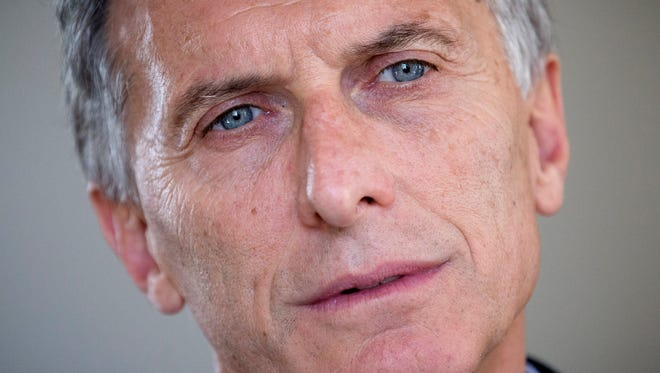 Argentina's President Mauricio Macri listens to a question during an interview with the Associated Press in Buenos Aires on March 16, 2016. He  said he believes that President Obama's upcoming visit will lead to billions in investment.