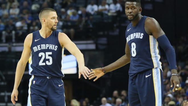 Oct 28, 2017;  Memphis Grizzlies forwards Chandler Parsons (25) and James Ennis III (8) celebrate after a three point shot by Parsons in the third quarter against the Houston Rockets at FedExForum.
