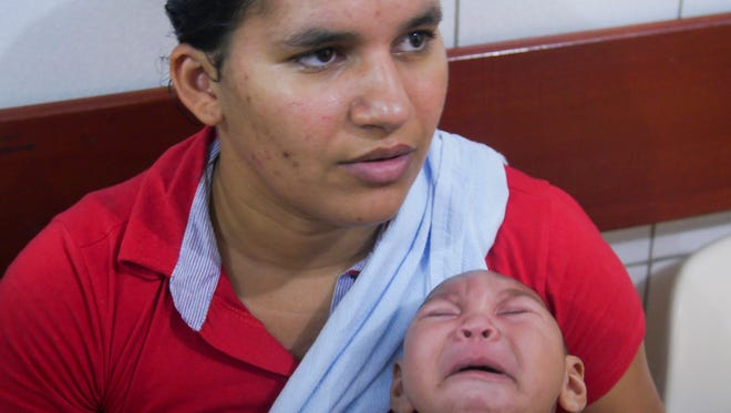 Jaqueline Vieira, 25, a mother from Recife, Brazil, holding her four-month-old son Daniel in the waiting room at Osvaldo Cruz medical center. Daniel suffers from microcephaly, believed to be caused by Jaqueline contracting the Zika virus during pregnancy.