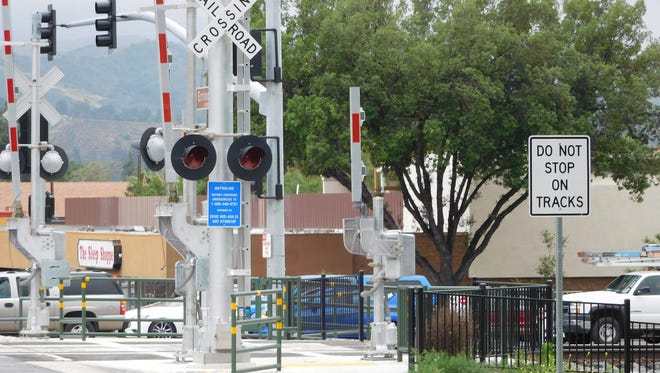 Different signs were put up at a railroad crossing in Simi Valley to avoid confusion, police said Wednesday. Authorities remind motorists to stop within 15 feet of railroad tracks.