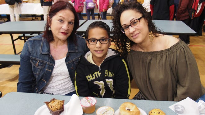 Grandma Carmen Rivera, grandson School No. 1 4th grader Ethan Gonzalez and daughter/mom Isabel Sosa enjoyed time together at the School No.1 Muffins for Mom breakfast.