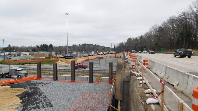 Workers are widening the Brevard Road bridge over Interstate 26 as part of a project to make several changes at the intersection.