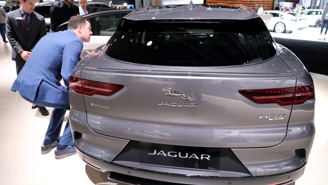 A Jaguar I-Pace gets a closer look on the floor of the New York International Auto Show.