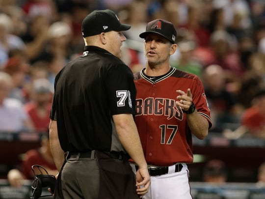 Sep 10, 2017; Phoenix, AZ, USA; Arizona Diamondbacks manager Torey Lovullo (17) talks to MLB umpire Tom Woodring (75) in between innings against the San Diego Padres at Chase Field. Mandatory Credit: Rick Scuteri-USA TODAY Sports