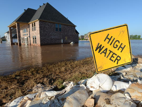 Water began to recede in the River Bluff subdivision Friday morning. Bossier Sheriff Julian Whittington and Senator Bill Cassidy toured the development with the media assessing the damage.