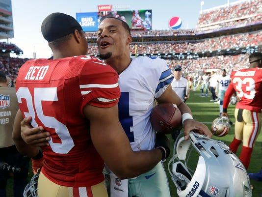 San Francisco 49ers safety Eric Reid (35) hugs Dallas Cowboys quarterback Dak Prescott (4) after an NFL football game in Santa Clara, Calif., Sunday, Oct. 2, 2016. (AP Photo/Marcio Jose Sanchez)
