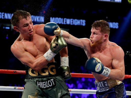 FILE - This Sept. 17, 2017 file photo shows Canelo Alvarez, right, fights Gennady Golovkin during a middleweight title fight in Las Vegas. Golovkin is growing frustrated with boxing's sanctioning bodies while he struggles to find a replacement opponent for Canelo Alvarez on May 5. The unbeaten middleweight champion's rematch with Alvarez in Las Vegas fell through after the Mexican star failed a doping test in February and finally withdrew from the bout last week. (AP Photo/John Locher,File)